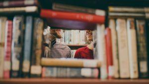 Students Between Book Cases