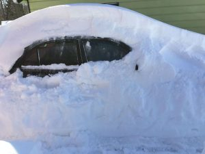 A Regina Car Covered in Snow