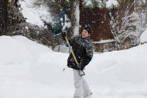 A School Boy from Saskatchewan Shovelling Snow
